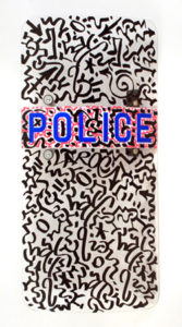 Police Shield, 2010 Oil and enamel marker on NYPD Shield 39.25 x 19 inches; 99.7 x 48.3 cm Signed